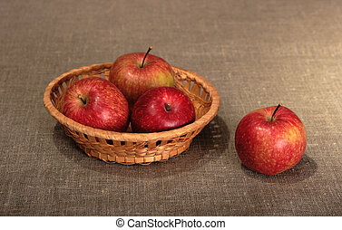 Group of a red apples in basket.