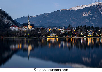Bled Lake with church and a city at twilight Slovenia
