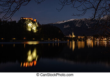Bled Lake with castle on church on hill and city in...