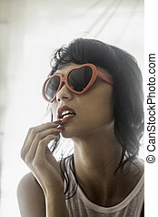 woman with red sunglasses