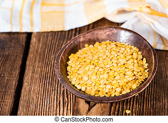 Yellow Lentils detailed close-up shot on wooden background