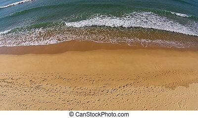 Waves Crashing on Beach, aerial view