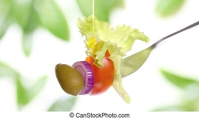 fork salad diet concept - fork salad with tomato olive oil...