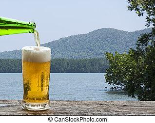 Enjoy beer with sea landscape.