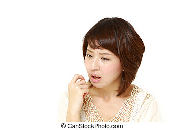 woman worries about something - studio shot of young...