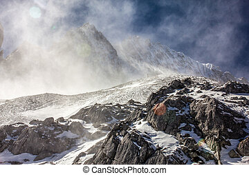 Snow Swept Peak - The Snow blows over the top of the peak of...