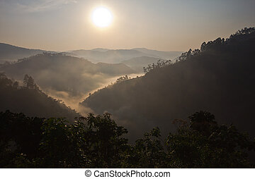 Sunrise over Bwindi - The sun rises over the Impenetrable...