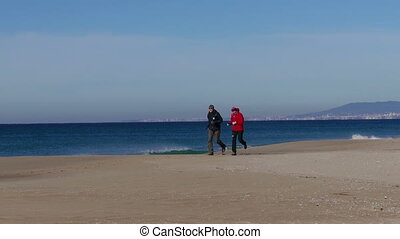 Middle-aged Couple Jogging on Beach
