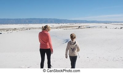 White Sands National Monument is a field of white sand dunes...