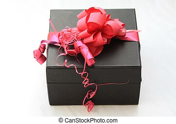 present - A black gift box with red decorations