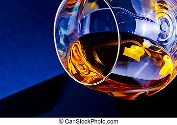 snifter of brandy in elegant glass with space for text on...