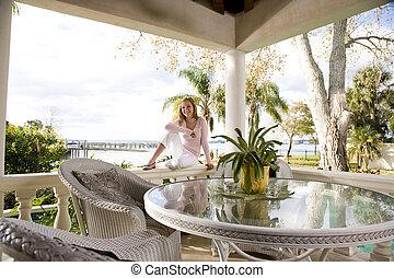 Teenage girl relaxing on terrace