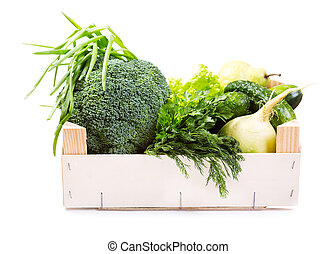 green vegetables and fruit in wooden box