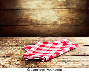 red tablecloth on wooden background - red tablecloth over...