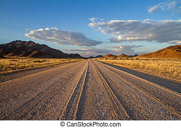 Sossusvlei desert, Namibia - Dirt road of the Sossusvlei...