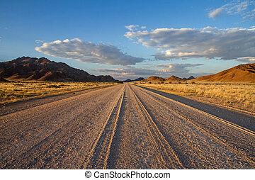 Sossusvlei desert, Namibia - Dirt road of the Sossusvlei...