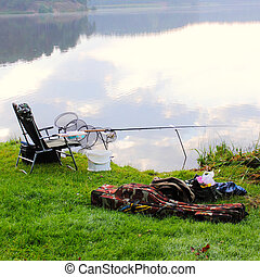 equipped place for fishing with a seat at sunrise with fog...