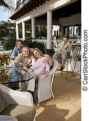 Family relaxing - Portrait of carefree family relaxing on...