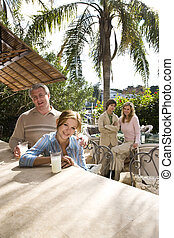 Family on vacation - Portrait of family relaxing on outdoor...