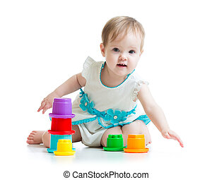 little girl playing with toys isolated