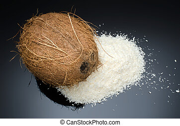 Desiccated coconut and whole coconut - Heap of desiccated...