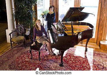 Piano practice - Portrait of teenage girl and younger...