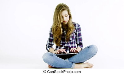 teenager girl with tablet in studio
