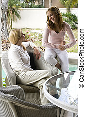 Mother-daughter talk - Mother and teenage daughter chatting...
