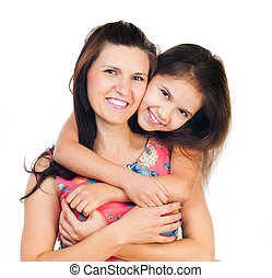 Little girl hugging her mother - Cute little girl hugging...