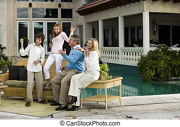 Family having fun - Family relaxing on patio together...