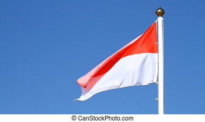 Flag of Monaco on a blue sky