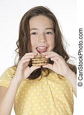 Caucasian Child - Cute Caucasian girl eating Chocolate Chip...