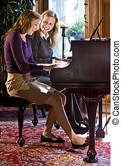 Mother daughter piano duet - Mother and daughter playing...