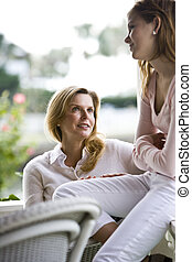 Mother daughter conversation - Mother and teen girl having...