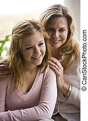 Mom and teenage daughter - Portrait of smiling mature woman...