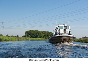 Boat on river - Barge at Dutch river the IJssel