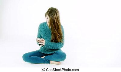 teenager taking selfie with phone
