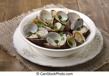 clams with wine sauce in a bowl - cooked clams in wine sauce...