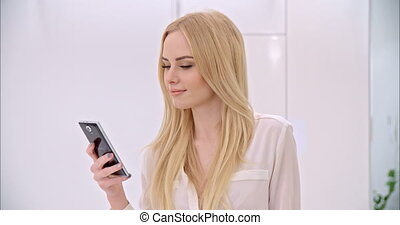 Young Blond Girl Using Mobile Phone