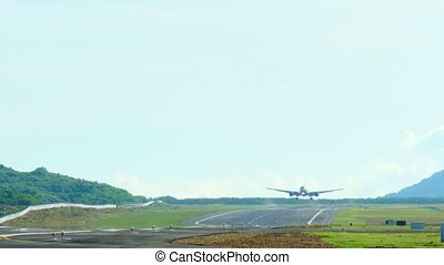 Landing - Widebody jet airplane touch down the runway,...