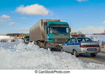 Trucks stopped on highway after heavy snow storm -...
