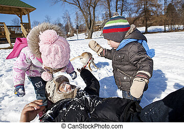 Family playing in snow.