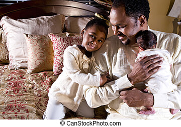 Family man - Father with newborn son and four year old...