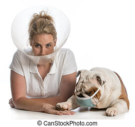 veterinary care - woman wearing elizabethan collar being...