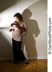 New mom - Happy African American mother holding newborn