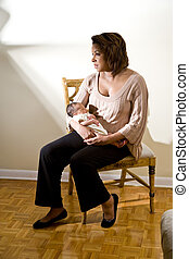 Baby blues - Mother with sad expression holding newborn