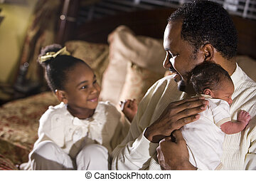 Family man - African American father with newborn and four...