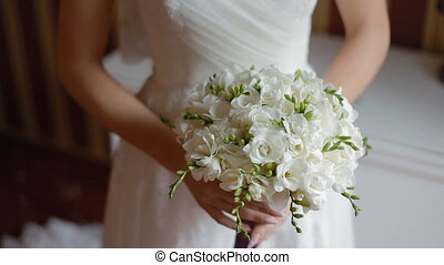 Bride held wedding bouquet in her arms - Nice wedding...