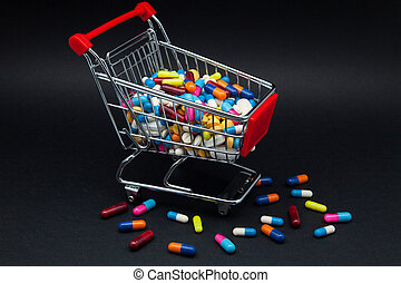 trade of pills and capsules on a black background