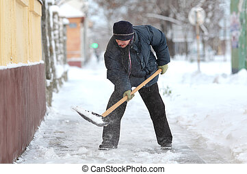 Winter time, snow removing - Caucasian woman cleaning snow...